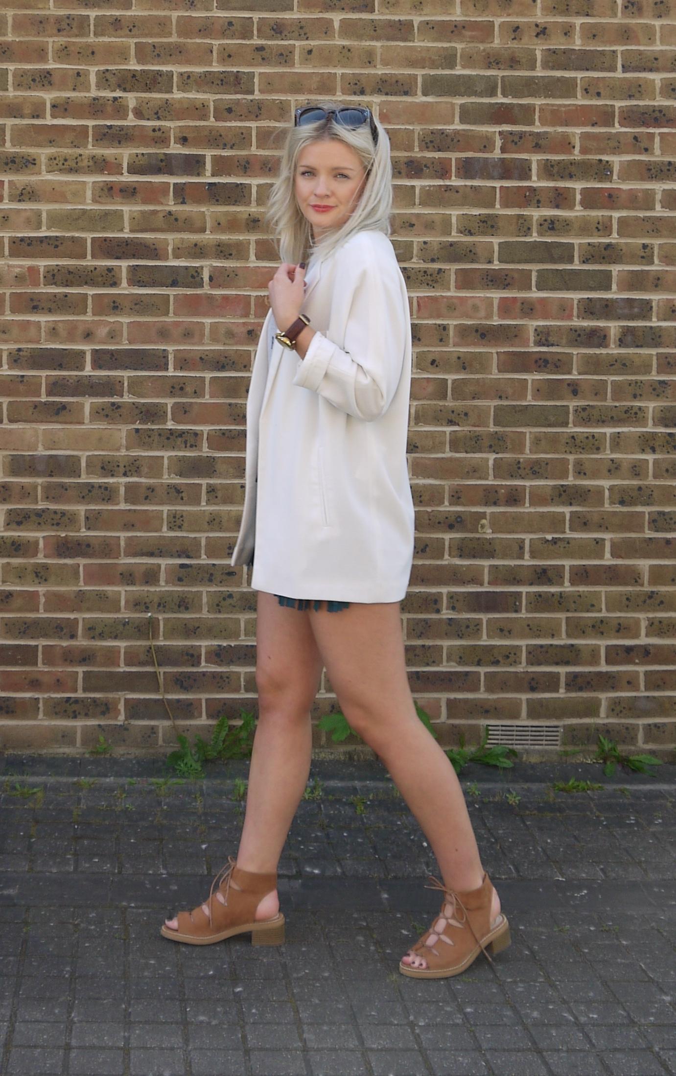 fringing shorts, white blazer, lace up tan sandals,  city chic, fashion blogger, laura byrnes, lauras little locket, festival look, celine preppy sunglasses,