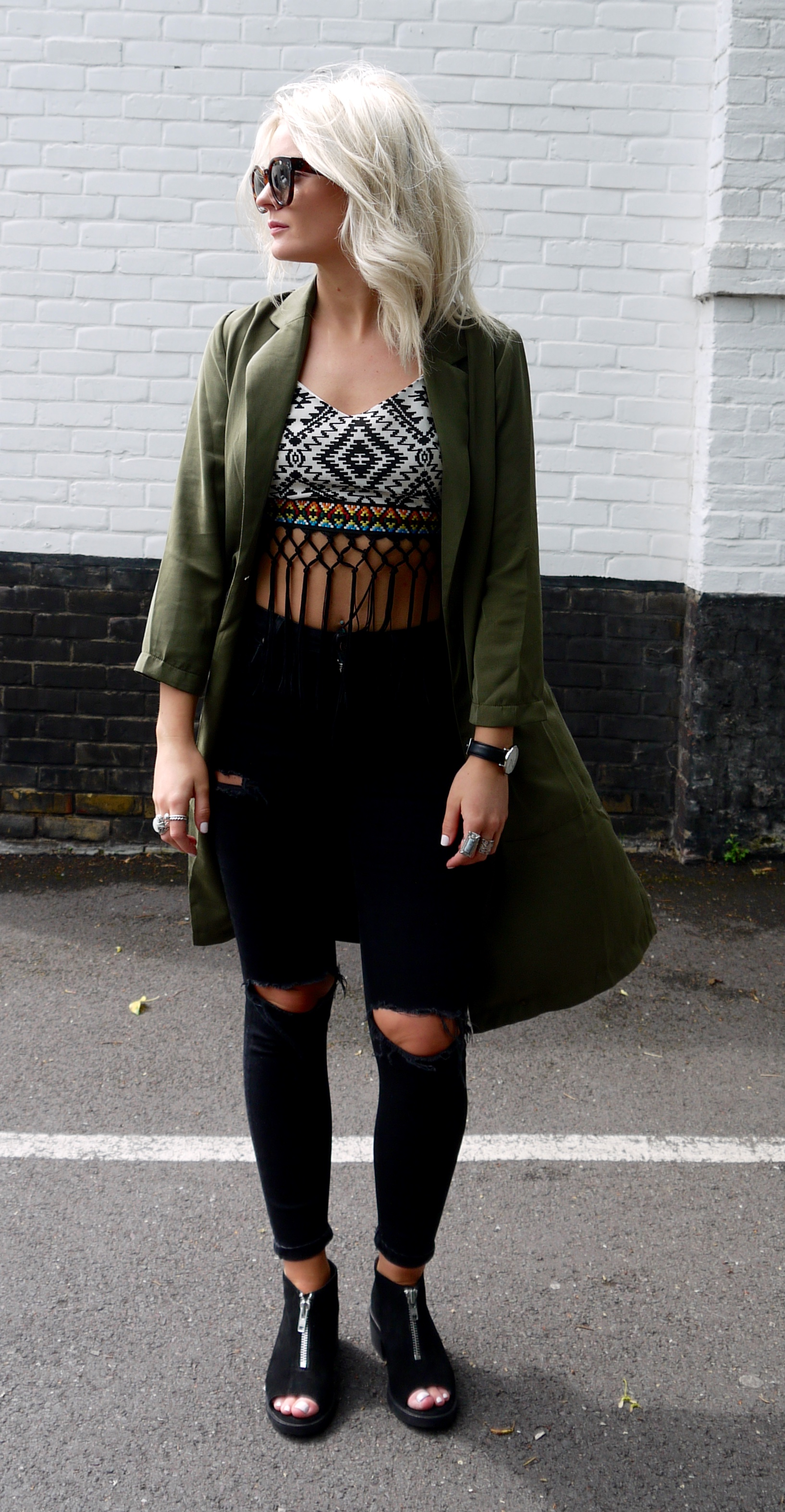 ripped black jeans, aztecs crop top, laura byrnes, lauras little locket, khaki duster jacket, blonde wavy hair, ashy blonde hair,