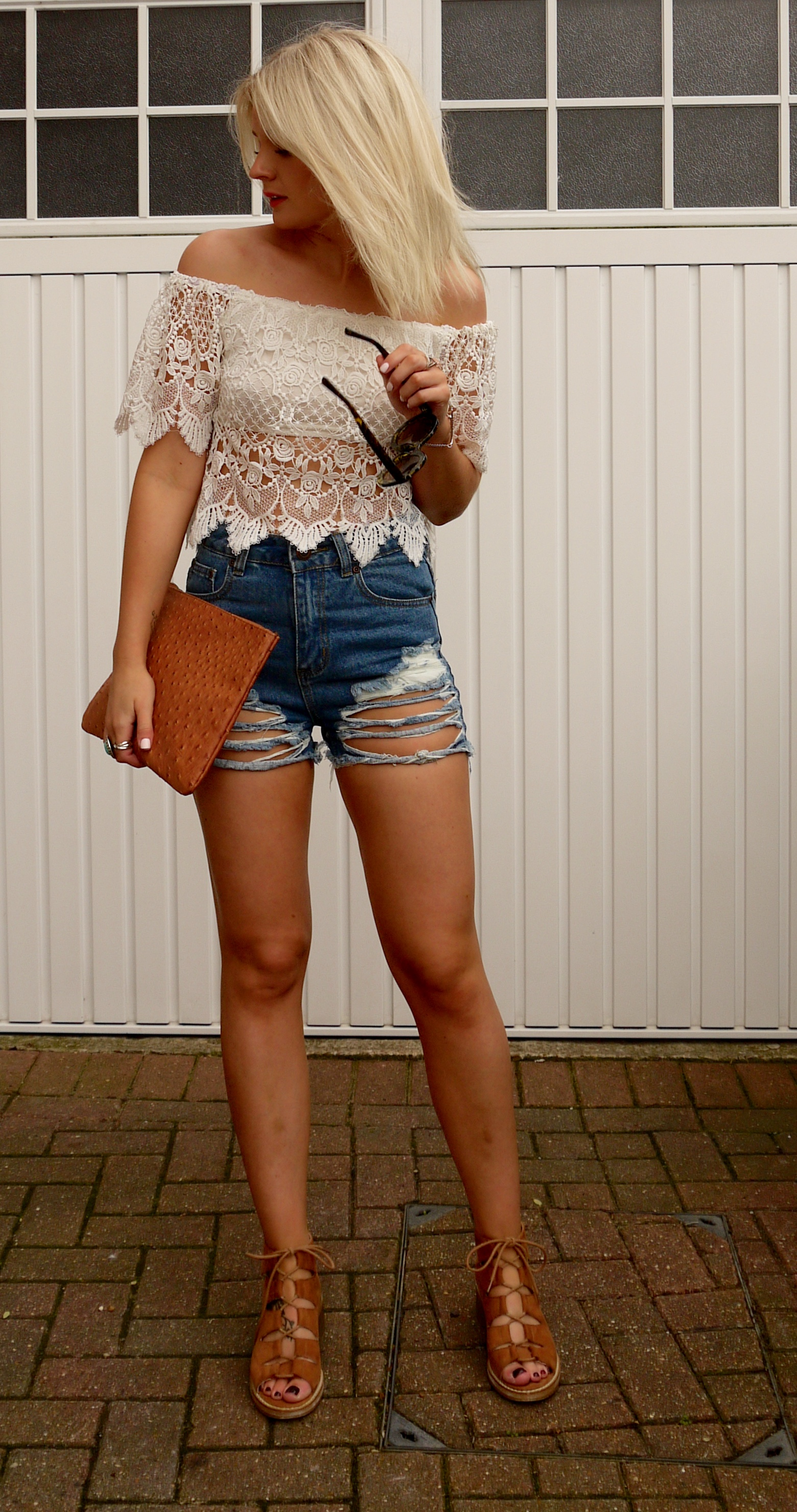 boohoo denin shorts, distressed shorts, crochet top, blonde hair, ash blonde hair, tan lace up sandals, round tortoise shell glasses, tan clutch bag, fashion blogger, laura byrnes , lauras little locket,