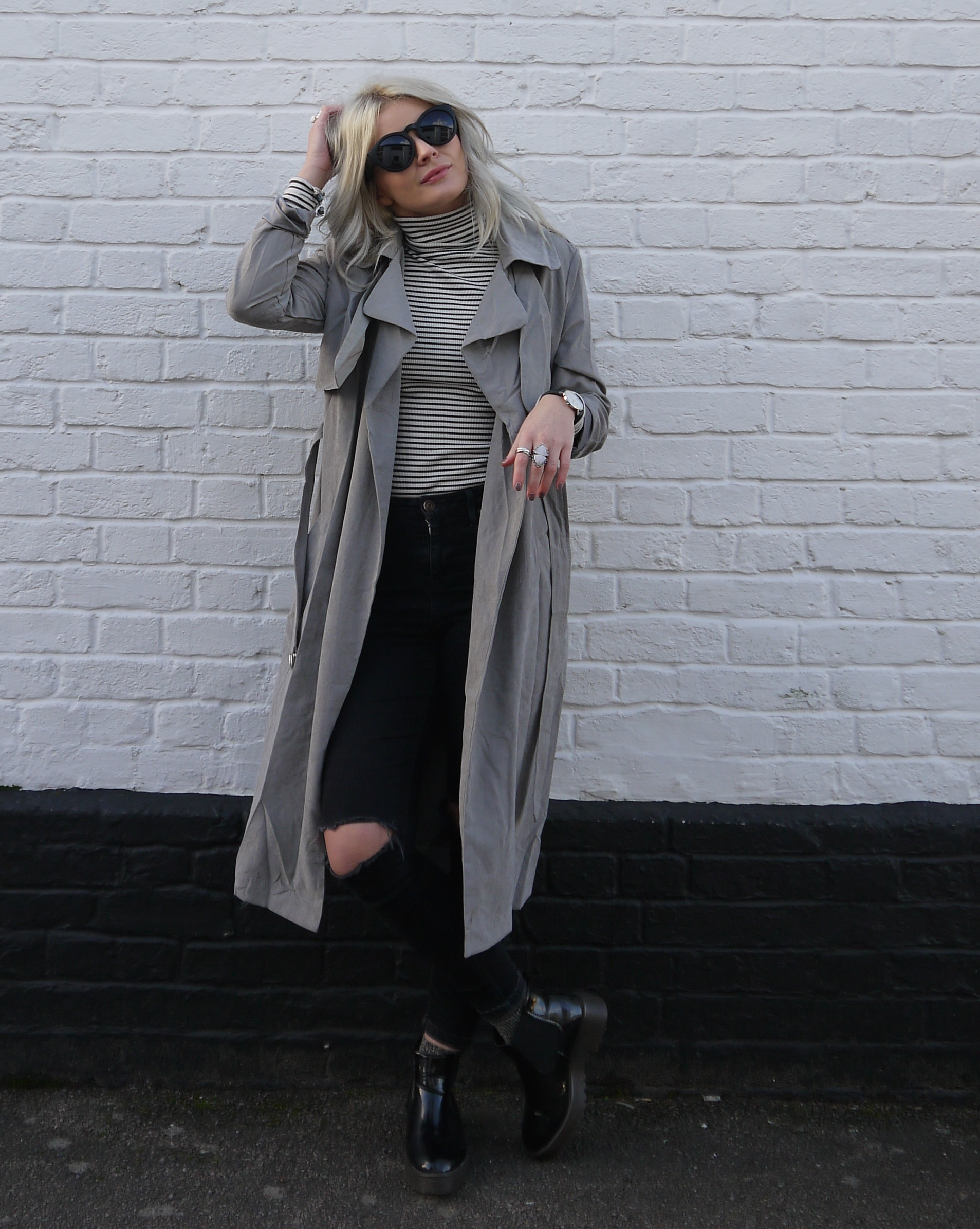 peached belted trench coat light grey, misguided grey trench coat,  stripe polo neck, fashion blogger, black ripped jeans, laura byrnes, lauras little locket