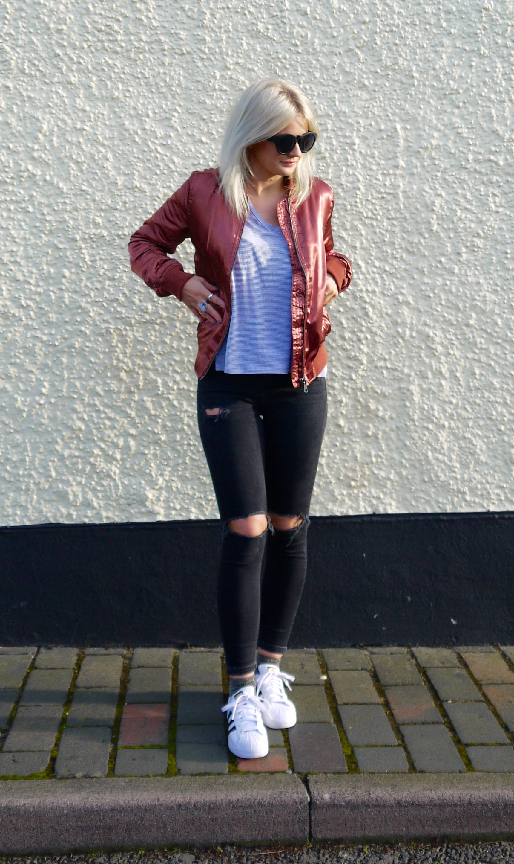 TOPSHOP ROSE GOLD BOMBER JACKET, BOMBER JACKET, LAURA BYRNES, LAURAS LITTLE LOCKED, BLACK RIPPED JEANS, ADDIDAS SUPERSTAR TRAINERS, ASH BLONDE HAIR,
