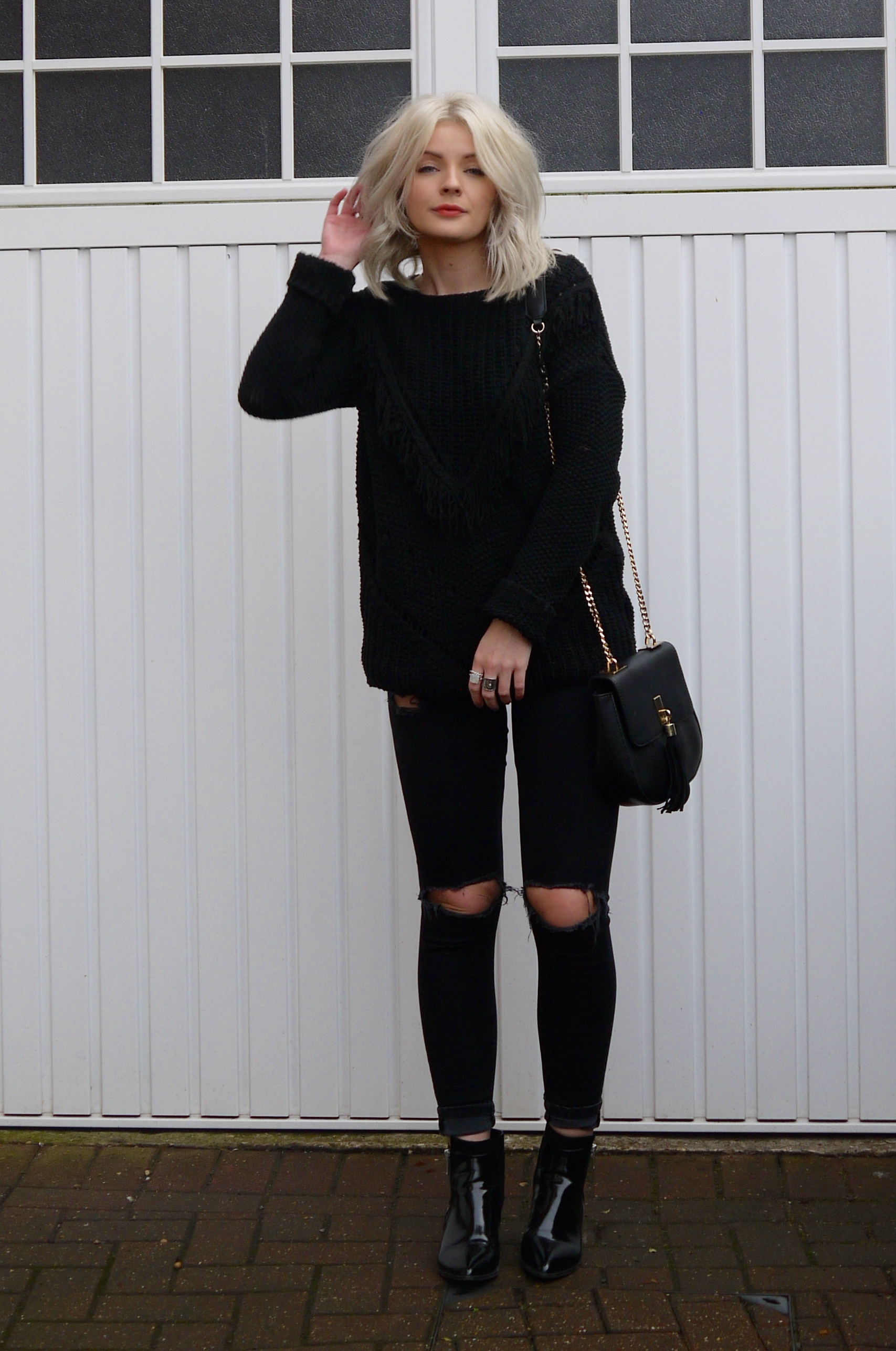 all black outfit, black jeans, black ankle boots, black chloe dupe bag, blonde wavy hair, laura byrnes, lauras little locket