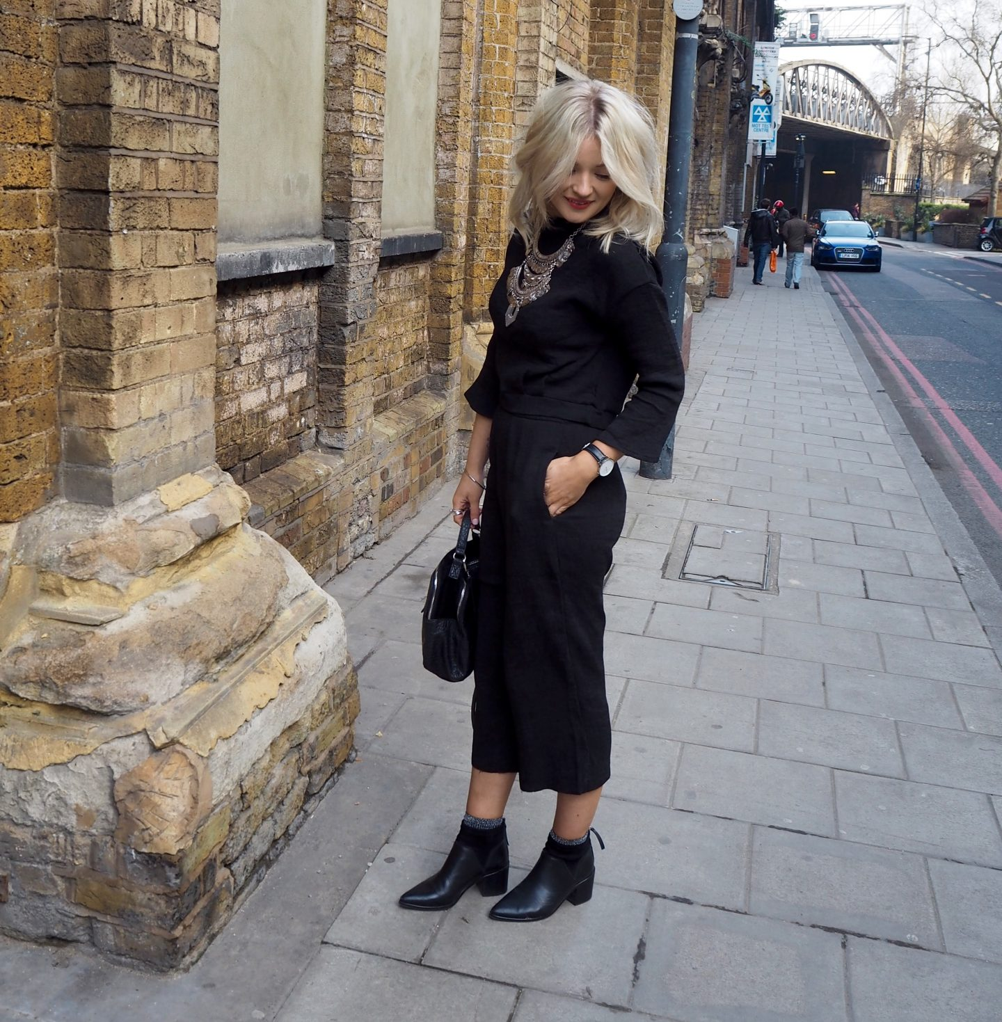 laura byrnes, lauras little locket, boohoo black culotte co-ord, blonde wavy hair, silver jewellery, black point boots, glitter socks,